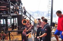 Visitors are boarding on a classic boat to travel on the sea of Hong Kong. Hong Kong, China - September 7, 2015: Visitors are boarding on a classic boat to Stock Photo