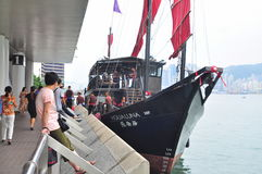 Visitors are boarding on a classic boat to travel on the sea of Hong Kong. Hong Kong, China - September 7, 2015: Visitors are boarding on a classic boat to Stock Photography