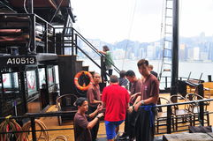 Visitors are boarding on a classic boat to travel on the sea of Hong Kong. Hong Kong, China - September 7, 2015: Visitors are boarding on a classic boat to Stock Photos