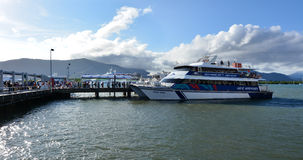 Visitors boarding on a cruise boat in Cairns Marlin Marina in Qu Royalty Free Stock Photo