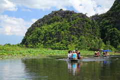 Visitors on boats to travel at TAM COC Stock Image