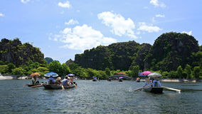 Visitors are on boats to visit Tam Coc royalty free stock photos