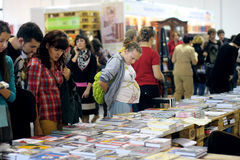 Visitors of the book fair. Visitors choose books at the 2-nd International Festival BOOK ARSENAL on October 7, 2012 in Kiev, Ukraine. The guests of the fair were Stock Photos