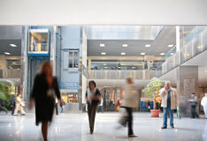 Visitors in business center. Motion blur Royalty Free Stock Photo
