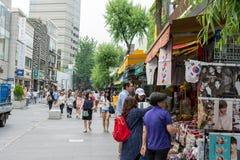 Visitors buying souvenirs at Insadong Street in Seoul, South Korea Stock Photos