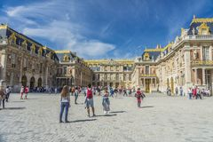 Visitors at the Chateau de Versailles in Paris, France. Tourists at the Chateau de Versailles in Paris, France royalty free stock photography