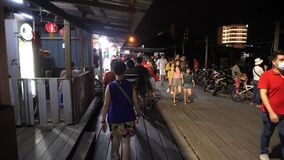 Visitors at Chew Jetty during night.