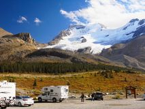 Canadian Rockies RV Cars, Banff Jasper NP, Icefields Parkway,. RV and visitors on parking lot near Columbia Glacier. Icefields Parkway. Banff Jasper National royalty free stock image