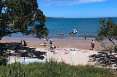 Visitors on coopers beach Northland New Zealand. COOPERS BEACH, NZ - DEC 27:Visitors on coopers beach.It's a famous holiday travel destination in Northland New Royalty Free Stock Image