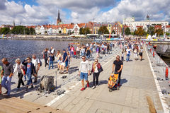 Visitors cross Oder river with military floating bridge during final of The Tall Ships Races 2017. Royalty Free Stock Photos
