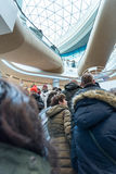 Visitors crowd on the escalator at the entrance to the mall. KIEV, UKRAINE - DECEMBER 04, 2016: The opening of the renewed shopping mall  CUM. Kiev, Ukraine Stock Photography