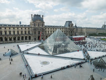 Visitors crowd main courtyard of the Louvre Royalty Free Stock Photo