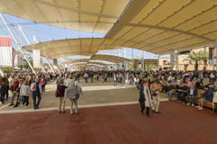 Visitors crowd under Decumano tensile membrane structure, EXPO 2. MILAN, ITALY - October 07, EXPO 2015, a crowd of visitors walks under the  tensile membrane Stock Photo