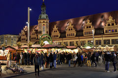 Visitors crowded Christmas market in Leipzig. LEIPZIG, GERMANY-DECEMBER 21, 2014: Visitors crowded Christmas market in historical center of Leipzig in evening Stock Photos