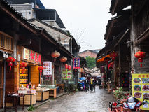 Visitors on eatery street in XingPing town. XINGPING, CHINA - MARCH 30, 2017: visitors on eatery street in Xing Ping town in Yangshuo county in spring. The town Royalty Free Stock Photography