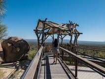Visitors enjoy shaded observation platform overlooking desert. Tucson, AZ, March 23, 2016: Visitors enjoy shaded observation platform at Arizona-Sonora Desert royalty free stock image