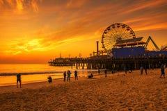 Visitors enjoy sunset above Santa Monica Pier in Los Angeles Royalty Free Stock Photo