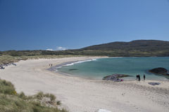 Visitors enjoy white sand beach at Caherdaniel, County Kerry Royalty Free Stock Images