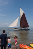 Visitors enjoy Whitstable beach and sea Kent, UK Royalty Free Stock Photography