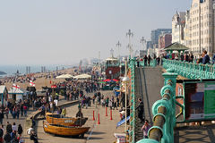 Visitors enjoying the beach at Brighton, UK Royalty Free Stock Image
