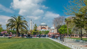 Visitors enjoying on a grass timelapse in front of Hagia Sophia Museum in Istanbul, Turkey. Hagia Sophia Park stock video