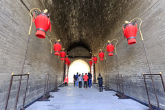 Visitors enter the gate of the ancient city of xian Stock Photography