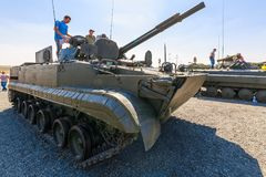 Visitors of the exhibition inspect the infantry fighting vehicle BMP-3. KADAMOVSKIY TRAINING GROUND, ROSTOV REGION, RUSSIA, 26 AUGUST 2017: International Royalty Free Stock Photography