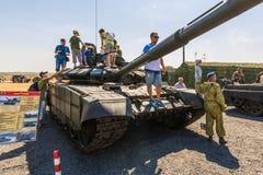 Visitors of the exhibition inspect the main tank T-72B3M. KADAMOVSKIY TRAINING GROUND, ROSTOV REGION, RUSSIA, 26 AUGUST 2017: International military technical Royalty Free Stock Photo