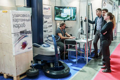 Visitors and exhibitors visiting the stands and exhibits. RUSSIA, MOSCOW - June 14, 2016: Visitors and exhibitors visiting the stands and exhibits at the Stock Image