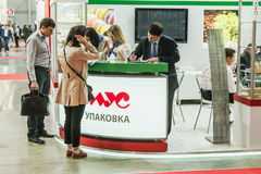 Visitors and exhibitors visiting the stands and exhibits. RUSSIA, MOSCOW - June 14, 2016: Visitors and exhibitors visiting the stands and exhibits at the Stock Photography