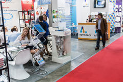 Visitors and exhibitors visiting the stands and exhibits at the. RUSSIA, MOSCOW - June 14, 2016: Visitors and exhibitors visiting the stands and exhibits at the Stock Image
