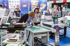 Visitors and exhibitors visiting the stands and exhibits at the. RUSSIA, MOSCOW - June 14, 2016: Visitors and exhibitors visiting the stands and exhibits at the Stock Photography