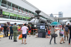 Visitors exploring the Apache at Army Open House 2017 in Singapore. Stock Photos