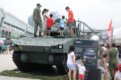 Visitors exploring the Bionix II tank at Army open house 2017 in Singapore. Stock Photography