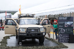 Visitors exploring the Ford Everst Protected Light Utility Vehicle at Army Open House 2017 in Singapore. Royalty Free Stock Photos