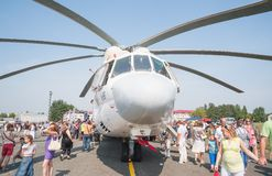 Visitors exploring the MI-26T helicopter Stock Photography