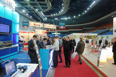 Visitors at ExpoCoating 2012 in Olimpyisky Sport Complex. MOSCOW - FEB 28: Visitors at ExpoCoating 2012 in Olimpyisky Sport Complex, Feb 28, Moscow, Russia. It royalty free stock images