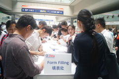 Visitors fill out personal information into the exhibition hall Stock Images