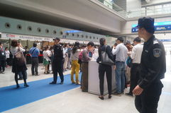 Visitors fill out personal information into the exhibition hall Royalty Free Stock Photo