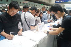 Visitors fill out personal information into the exhibition hall Royalty Free Stock Image