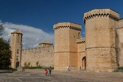 Visitors of the fortified Poblet. POBLET / SPAIN - SEPTEMBER 2014: Visitors of the fortified Poblet Monastery, Spain royalty free stock image