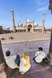 Visitors in front of the Jama Masjid Mosque in Old Delhi Stock Photo