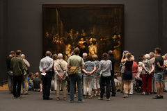 Visitors in front of the Night Watch Royalty Free Stock Images