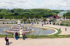 Visitors in garden Palace Versailles with statue and pond at Paris, France Royalty Free Stock Photo