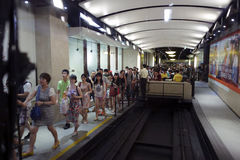 Visitors getting on  tram in line Royalty Free Stock Images