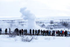 Visitors at the geyser erruption of Strokkur, Iceland Royalty Free Stock Photo