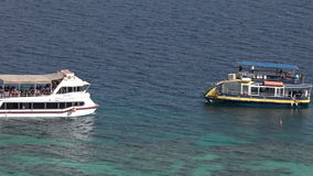 Visitors on a glass boat on Coral Beach Nature Reserve in Eilat, Israel. EILAT, ISR - APRIL 14 2015:Visitors on a glass boat on Coral Beach Nature Reserve in stock footage