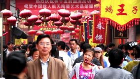 Visitors go in and out Wangfujing Snack Street stock footage