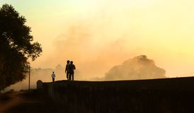 Visitors going walks on the big fort large wall at vellore fort with sunset Stock Photos