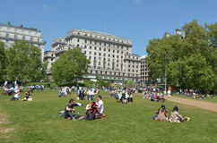 Visitors at Green Park on Sunny day in London Stock Images